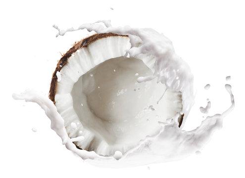 Cracked coconut with  splashes isolated on white backround