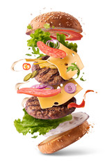 Delicious burger with flying ingredients