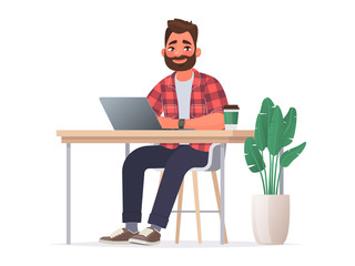 Business man at the desktop with a laptop. Freelancer or office worker