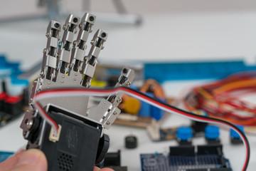 Mechanical model of human palm. Robot arm