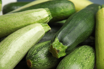 Fresh ripe green zucchini as background, closeup