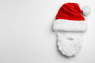 Fotobehang - Santa Claus hat with beard on white background, top view
