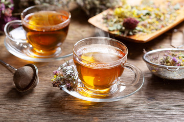 Cups of herbal tea with various herbs