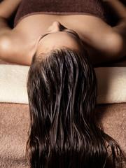 Obraz Woman receiving hair care procedure  in spa salon - fototapety do salonu