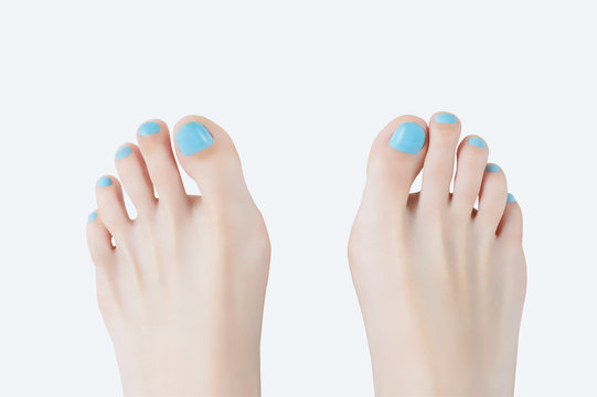Pedicure. Legs close up. White background. Nail polish.