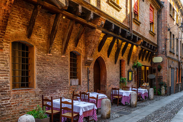 Cozy street with old houses in Ferrara, Emilia-Romagna, Italy. Ferrara is capital of the Province of Ferrara.