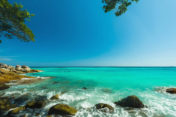 Wall Mural - Wonderful turqoise sea and water splash at Andaman sea, Beautiful beach in summer at Surin Island, Thailand
