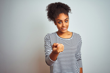 African american woman wearing navy striped t-shirt standing over isolated white background Beckoning come here gesture with hand inviting welcoming happy and smiling