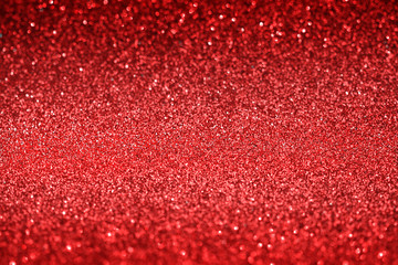Red glitter texture christmas abstract background,   Defocused Fototapete