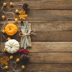 Thanksgiving background, pumpkin, leaves and decoration on wood table background with copy space. flatlay