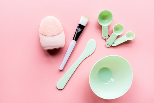 set for making facial mask on pink background. Beauty concept. Modern device. Flat lay, mockup, top view, overhead. Skin care and health concept