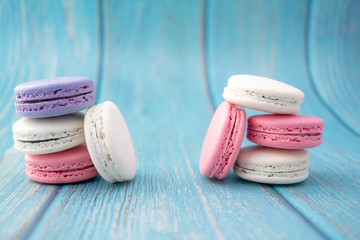 Foto auf Leinwand Macarons Cake macaron or macaroon on turquoise background from above, colorful almond cookies, pastel colors