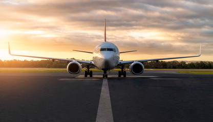 Foto op Aluminium Vliegtuig Sunset view of airplane on airport runway under dramatic sky in Hobart,Tasmania, Australia. Aviation technology and world travel concept.