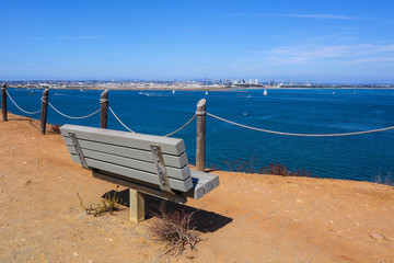A bench sits overlooking San Diego bay on the Bayside Trail at Cabrillo National Monument in Point Loma, California.