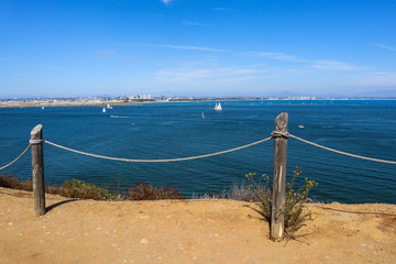 A rope fence on the Bayside Trail at Cabrillo National Monument in Point Loma, California which offers scenic views of San Diego Bay.
