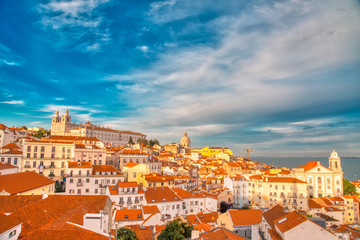 Scenic Alfama lookout with San Vicente (Saint Vincent) statue and Sao Vicente de Fora a church on the background