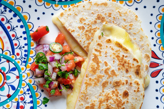 """Mexican quesadillas with sliced ham also called """"sincronizadas"""" on colorful  background"""