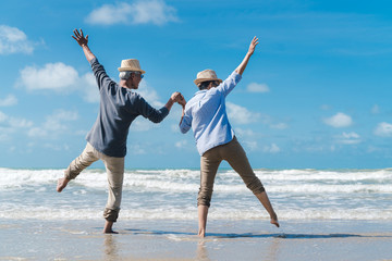 Asian couple senior elder retire resting relax dancing at sunset beach honeymoon family together happiness people lifestyle, Slow motion footage