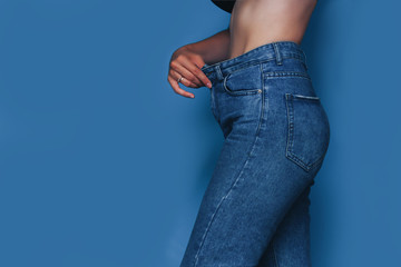 skinny woman body with Loose pants jeans, Light weight body with loose clothes, slender and Healthy body low fat concept