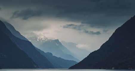Panorama of gloomy cloudy Norwegeian mountains and Hardanger fjord, Norway
