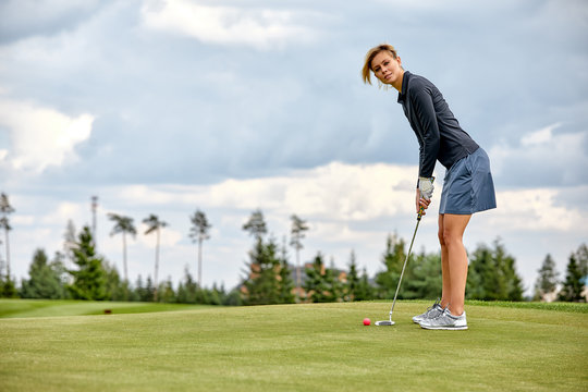 Goal concept, copy space. Women golfing time holding golf equipment on green field background. The pursuit of excellence, personal craftsmanship, royal sport, sports banner.