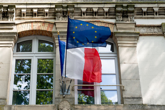 French and EU European Union flags fluttering on the city hall in France