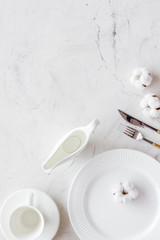 Elegant table setting with plates and tableware on marble background top view mock-up