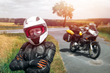Girl driver portrait, protective equipment, turtle. body armor jacket. Adventure motorbike with bags. a motorcycle tour journey. light warm tinting, glow, freedom concept. safety first, safe driving Fototapete