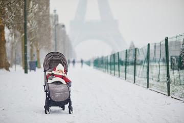 Little kid enjoying the very first snow