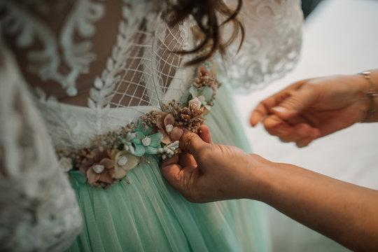 Detail of wedding dress last minute preparation.