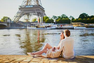 Happy romantic couple in Paris, near the Eiffel tower