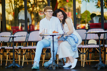 Happy romantic couple in Paris, drinking coffee