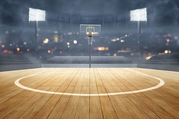 Basketball court with wooden floor, lights reflectors, and tribune
