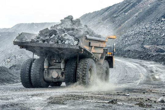 Large quarry dump truck. Transport industry.
