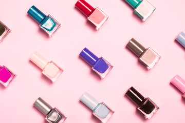 Nail polish bottles pattern background. Close up.