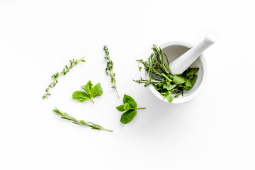 Store up medicinal herbs on white background top view Wall mural
