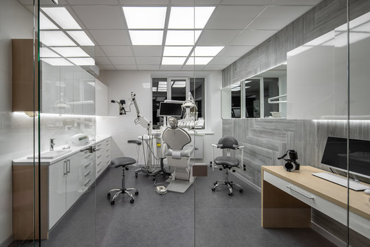 Contemporary dental clinic with light interior and hi-tech equipment