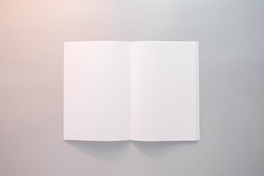 Blank magazine, notebook, brochure, booklet or book with softcover mockup template in the sunlight on gray background