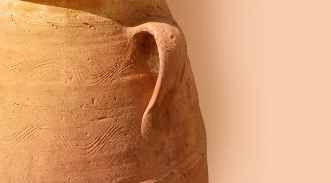 Close-up greek terracotta amphora as background