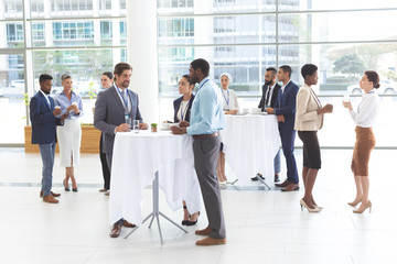 Business people interacting with each other at table during a seminar