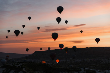 Cappadocia hot air balloon view in dawn, Turkey Wall mural