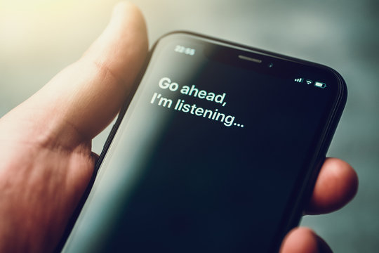 Voice activated digital assistant on smartphone and text on screen: Go ahead, I'm listening...