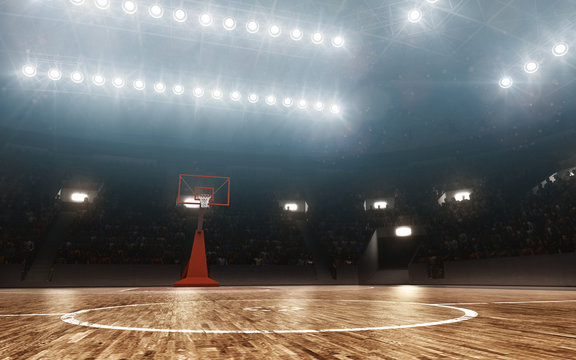 Empty professional basketball arena. Floodlit background