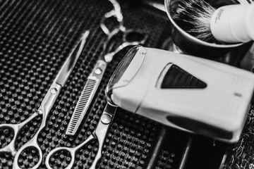 Barber tools. Hairdresser's workplace. A great plan. Black and white photo.