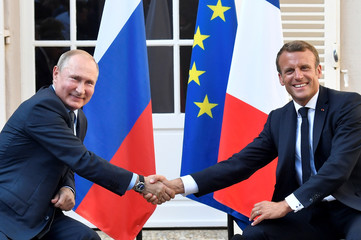 French President Emmanuel Macron meets with Russia's President Vladimir Putin, at his summer retreat of the Bregancon fortress on the Mediterranean coast, near the village of Bormes-les-Mimosas