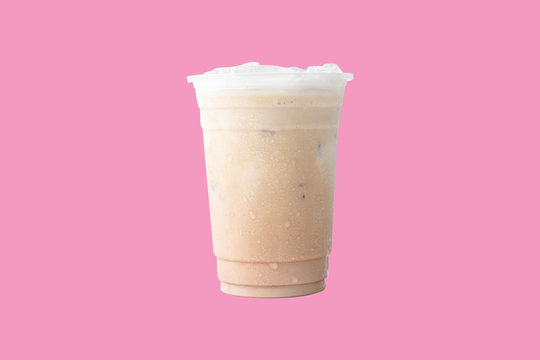 Iced or frappe coffee cup on glass cup isolated on pink pastel background