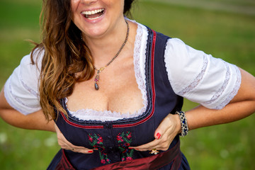 brunette laughing woman in drindl showing her cleavage