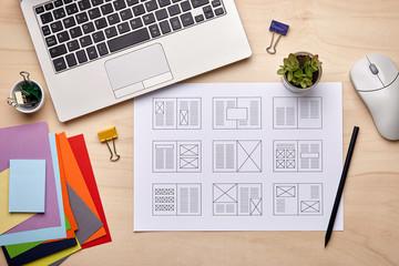 Editorial designer desk with publication layout