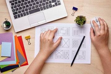 Editorial designer working on publication layout