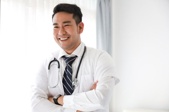 portait of Asian doctor in hospital white background